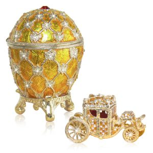 Golden Coronation egg set with a faberge carriage trinket box